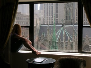 Jess looking out the hotel room window
