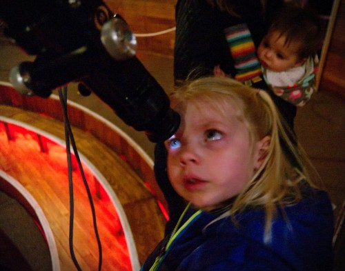Moonlight hitting Heather's eye through the Clark Telescope at Lowell Observatory